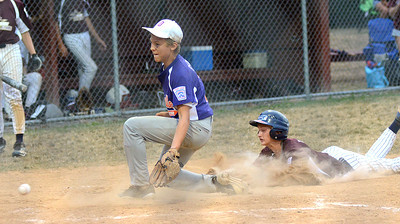 Shik Acorn's Chris Tasker slides into home ahead of the toss to Danville's Tyler Fisher during the D13 Junior Division final Friday July 13, 2012 at Monroe Township Park.