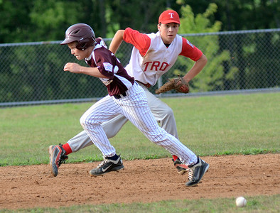 Shikellamy's Gabe Tilford heads to third base as Troy's Mitchell Morse moves toward the ball during their game Saturday July 21, 2012 at the Monroe Township Park.
