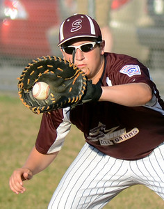 Shikellamy's Chad Sulouff makes the catch at first for the out during their game against Troy Saturday July 21, 2012 at Monroe Township Park.