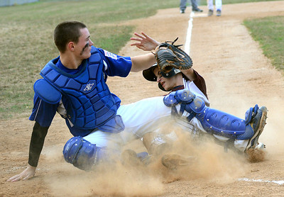 Shikellamy's Kyle Leitzel slides in under Mountoursville's Curtis Miller to score during their game Wednesday July 18, 2012 at the Montour Township Park.