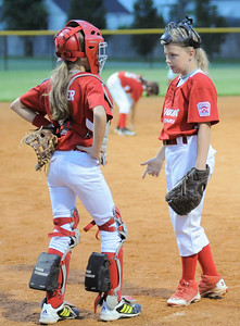 Jeff/GRC All-Star catcher Julia Stumler, left, talks with pitcher Savannah Gaither between innings during Friday's 9/10 year old Indiana State softball Tournament game against Bedford. Photo by Joe Ullrich
