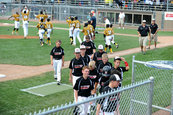 The New Albany 11-12 All Stars exit the field after their 12-7 loss to Chicago's Jackie Robinson West in the Great Lakes Region championship game at Stokely Field in Indianapolis Saturday.  Staff photo by Tyler Stewart