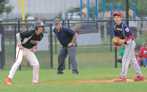 New Albany All-Star Jonah Boone takes a lead-off at third base during Friday's 13/14 year old Indiana State tournament game against Bedford. Photo by Joe Ullrich