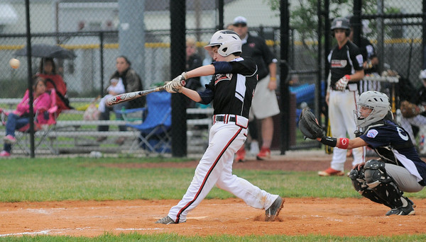 New Albany All-Star Courtland Black gets a hit during Friday's 13/14 year old Indiana State tournament game against Bedford. Photo by Joe Ullrich