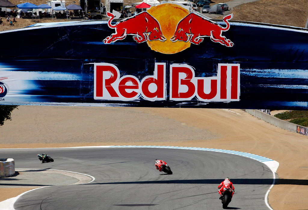 . Riders exit the corkscrew at Mazda Raceway Laguna Seca during the Red Bull U.S. Grand Prix in Monterey on July 21, 2013.  Marc Marquez went on to win the race.  (Vern Fisher/Monterey County Herald)