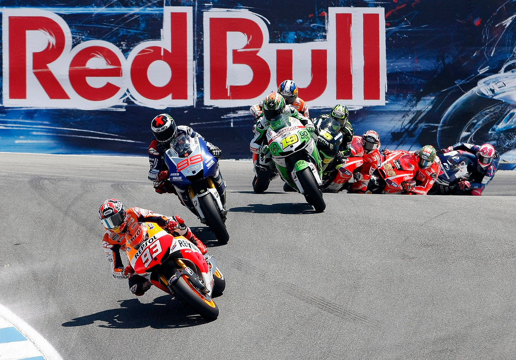 . Marc Marquez from Spain heads in to the corkscrew with a group of riders behind at Mazda Raceway Laguna Seca during the Red Bull U.S. Grand Prix in Monterey on July 21, 2013.  Marquez went on to win the race.  (Vern Fisher/Monterey County Herald)