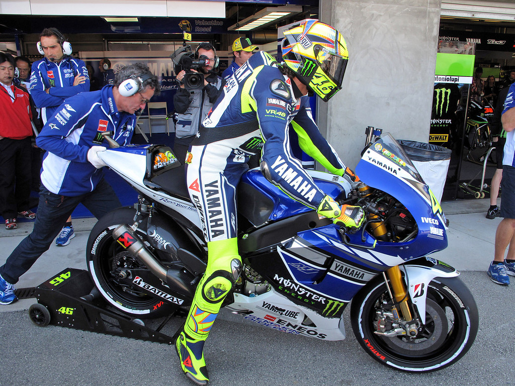 . Valentino Rossi from Italy gets on his Yamaha YZR M-1 at Mazda Raceway Laguna Seca for the morning warm-up session for the Red Bull U.S. Grand Prix in Monterey on July 21, 2013.  (Vern Fisher/Monterey County Herald)