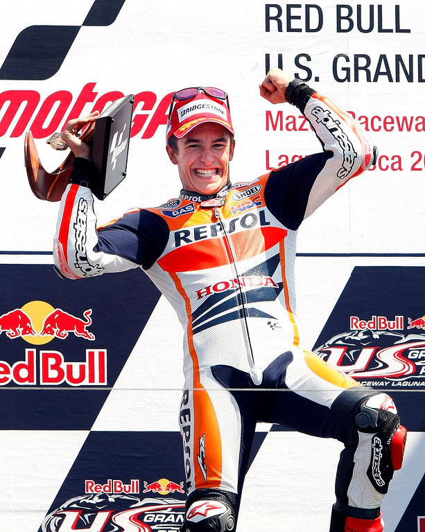 . Marc Marquez from Spain on the podium at Mazda Raceway Laguna Seca during the Red Bull U.S. Grand Prix in Monterey on July 21, 2013.  Marquez went on to win the race.  (Vern Fisher/Monterey County Herald)