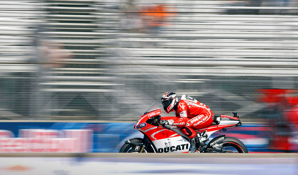 . Andrea Dovizioso from Italy races down the staright on his Ducati at Mazda Raceway Laguna Seca during the morning warm-up session for the Red Bull U.S. Grand Prix in Monterey on July 21, 2013.  (Vern Fisher/Monterey County Herald)