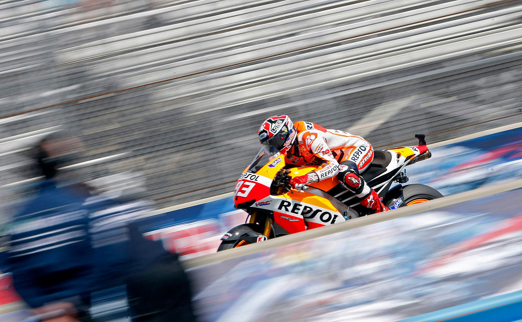 . Marc Marquez from Spain races down the straight at Mazda Raceway Laguna Seca during the Red Bull U.S. Grand Prix in Monterey on July 21, 2013.  Marquez went on to win the race.  (Vern Fisher/Monterey County Herald)