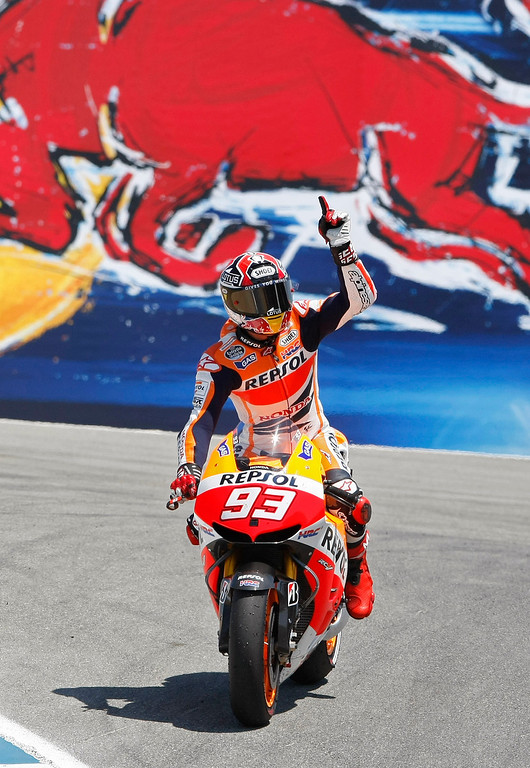 . Marc Marquez from Spain waves to the crowd in the corkscrew at Mazda Raceway Laguna Seca during the Red Bull U.S. Grand Prix in Monterey on July 21, 2013.  Marquez went on to win the race.  (Vern Fisher/Monterey County Herald)