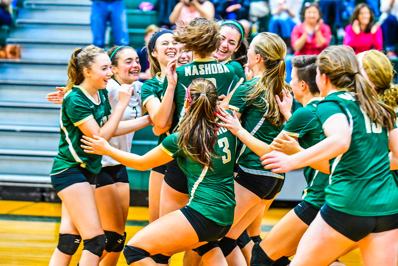 The Nashoba Regional girls' volleyball team celebrates after a league-title-clinching 3-2 victory over North Middlesex in Bolton. SENTINEL & ENTERPRISE / ED NISER