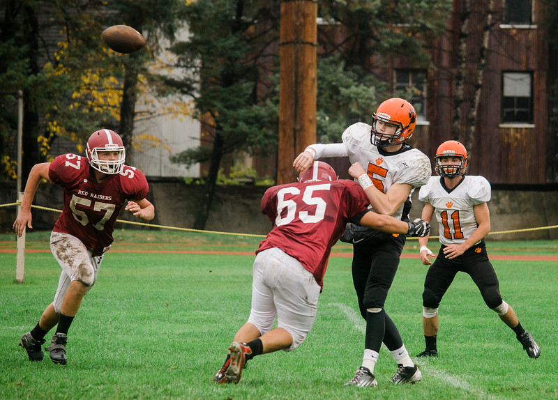 Fitchburg's Adam Ramos brings down Marlborough's Evan Schmidlein during the game at Crocker Field on Saturday morning. SENTINEL & ENTERPRISE / Ashley Green
