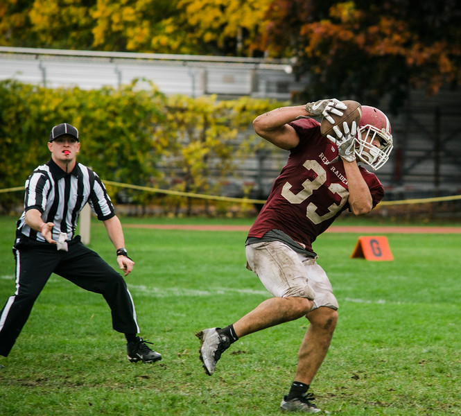 Fitchburg's Alex Marrero makes a catch during the game against Marlborough on Saturday morning. SENTINEL & ENTERPRISE / Ashley Green