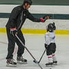 Former Boston Bruin and NHL veteran Hal Gill high 5's (so to speak) a participant of the Little Bruins Youth Hockey Program at the Gaetz Arena at Wallace Civic Center. SENTINEL&ENTERPRISE/ Jim Marabello