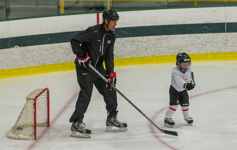 Former Boston Bruin and NHL veteran Hal Gill plays defense against a participant of the Little Bruins Youth Hockey Program at the Gaetz Arena at Wallace Civic Center. SENTINEL&ENTERPRISE/ Jim Marabello