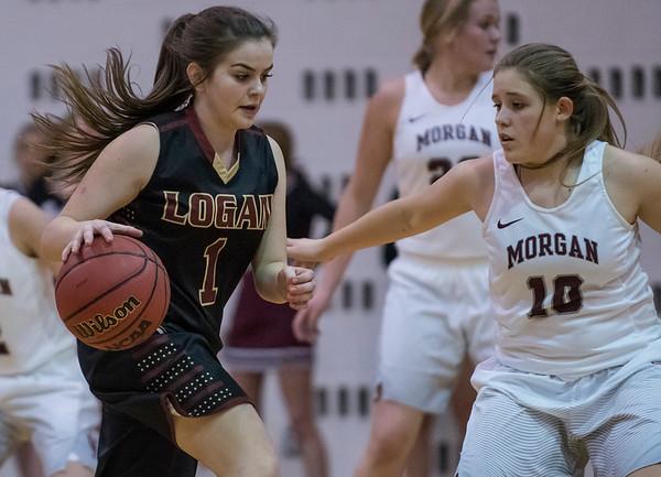 Aleya Zentner (1) drives the ball around the Morgan defender Lisa Blazzard (10) on Thursday night matchup at Morgan High School on January 12, 2017.