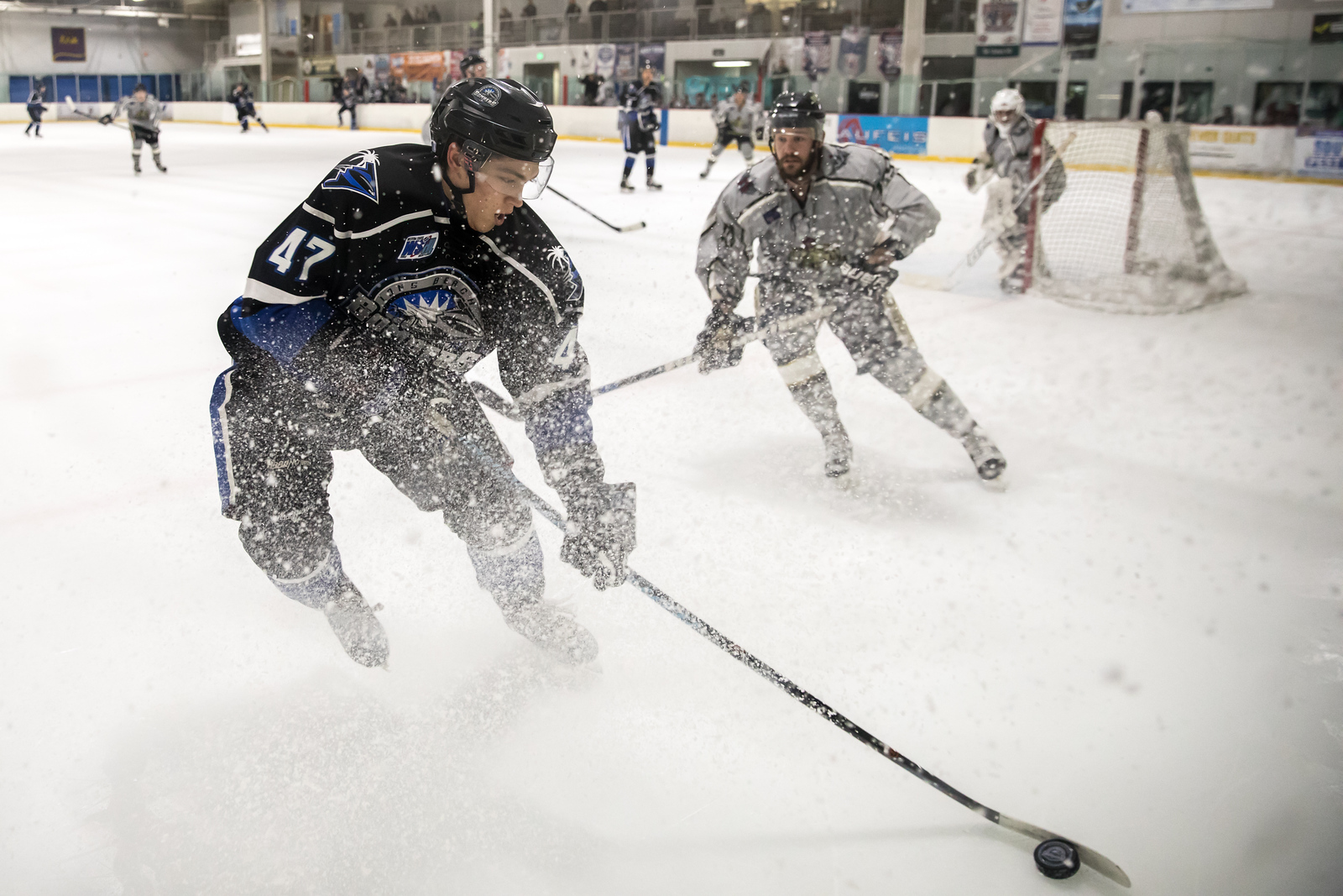 Forward Kiril Markevich of the Long Beach Bombers throwing some ice fending off a souther organ defenseman @lbbombershockey @pt_gazettessports