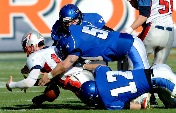"Longmont's Alonzo Garcia (5), Brandon Deines (12), and Heritage's Mitch Griebel (13) scramble for a fumbled ball during the class 4A state championships at Invesco Field at Mile High Stadium in Denver, Saturday, Dec. 5, 2009. Heritage High School won the title, 42-28. <br /> <br /> For more photos, please visit  <a href=""http://www.dailycamera.com"">http://www.dailycamera.com</a><br />  <br /> KASIA BROUSSALIAN / THE CAMERA"