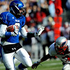 """Longmont's Nick Chopp (9) blocks Heritage's Jimmy Ellis (3) while carrying the ball during the class 4A state championships at Invesco Field at Mile High Stadium in Denver, Saturday, Dec. 5, 2009. Heritage High School won the title, 42-28. <br /> <br /> For more photos, please visit  <a href=""""http://www.dailycamera.com"""">http://www.dailycamera.com</a><br />  <br /> KASIA BROUSSALIAN / THE CAMERA"""