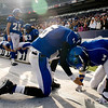 "Longmont's Alonzo Garcia (5) gives a hand to teammate Nick Chopp after losing to Heritage High School during the class 4A state championships at Invesco Field at Mile High Stadium in Denver, Saturday, Dec. 5, 2009. Heritage High School won the title, 42-28. <br /> <br /> For more photos, please visit  <a href=""http://www.dailycamera.com"">http://www.dailycamera.com</a><br />  <br /> KASIA BROUSSALIAN / THE CAMERA"