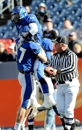 """Longmont's Dawlton Cole (17) lifts teammate Nick Chopp (9) after Chopp scores a touchdown against Heritage High School during the class 4A state championships at Invesco Field at Mile High Stadium in Denver, Saturday, Dec. 5, 2009. Heritage High School won the title, 42-28. <br /> <br /> For more photos, please visit  <a href=""""http://www.dailycamera.com"""">http://www.dailycamera.com</a><br />  <br /> KASIA BROUSSALIAN / THE CAMERA"""