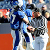 "Longmont's Dawlton Cole (17) lifts teammate Nick Chopp (9) after Chopp scores a touchdown against Heritage High School during the class 4A state championships at Invesco Field at Mile High Stadium in Denver, Saturday, Dec. 5, 2009. Heritage High School won the title, 42-28. <br /> <br /> For more photos, please visit  <a href=""http://www.dailycamera.com"">http://www.dailycamera.com</a><br />  <br /> KASIA BROUSSALIAN / THE CAMERA"