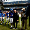 "Longmont's Devin Strauss (1) and head coach Doug Johnson recieve the second place trophy after losing to Heritage High School during the class 4A state championships at Invesco Field at Mile High Stadium in Denver, Saturday, Dec. 5, 2009. Heritage High School won the title, 42-28. <br /> <br /> For more photos, please visit  <a href=""http://www.dailycamera.com"">http://www.dailycamera.com</a><br />  <br /> KASIA BROUSSALIAN / THE CAMERA"