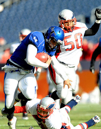 "Longmont's Jake Johnson (14) carries the ball while Heritage's Jimmy Ellis (3) and Marcus Neal (50) go for a tackle during the class 4A state championships at Invesco Field at Mile High Stadium in Denver, Saturday, Dec. 5, 2009. Heritage High School won the title, 42-28. <br /> <br /> For more photos, please visit  <a href=""http://www.dailycamera.com"">http://www.dailycamera.com</a><br />  <br /> KASIA BROUSSALIAN / THE CAMERA"