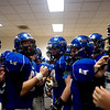 "The Longmont Trojans prepare themselves for the second half of the game in the locker room during the class 4A state championships against Heritage High School at Invesco Field at Mile High Stadium in Denver, Saturday, Dec. 5, 2009. Heritage High School won the title, 42-28. <br /> <br /> For more photos, please visit  <a href=""http://www.dailycamera.com"">http://www.dailycamera.com</a><br />  <br /> KASIA BROUSSALIAN / THE CAMERA"