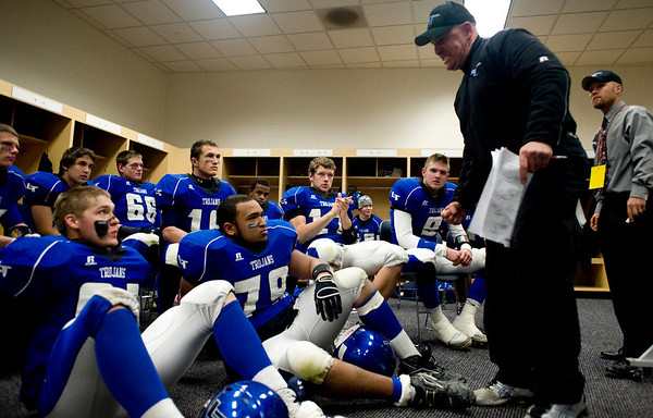"""Longmont High School head coach Doug Johnson gives a pep talk in the locker room before the second half during the class 4A state championships against Heritage High School at Invesco Field at Mile High Stadium in Denver, Saturday, Dec. 5, 2009. Heritage High School won the title, 42-28. <br /> <br /> For more photos, please visit  <a href=""""http://www.dailycamera.com"""">http://www.dailycamera.com</a><br />  <br /> KASIA BROUSSALIAN / THE CAMERA"""
