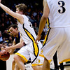 Longmont's Tevan McIntire (left) passes around Pueblo East's  Mitch Secora during the semifinals of the boys 4A State Championships at the Coors Event Center on the University of Colorado campus in Boulder, Thursday, March 11, 2010. <br /> <br /> KASIA BROUSSALIAN