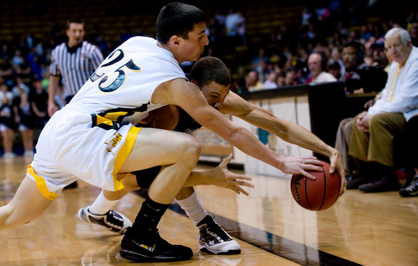Longmont's Syd Donaldson (behind) stretches for the ball with Pueblo East's Erik Kochenberger during the semifinals of the boys 4A State Championships at the Coors Event Center on the University of Colorado campus in Boulder, Thursday, March 11, 2010. <br /> <br /> KASIA BROUSSALIAN
