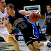 Longmont's Syd Donaldson (right) pushes past Pueblo East's Erik Kochenberger during the semifinals of the boys 4A State Championships at the Coors Event Center on the University of Colorado campus in Boulder, Thursday, March 11, 2010. <br /> <br /> KASIA BROUSSALIAN