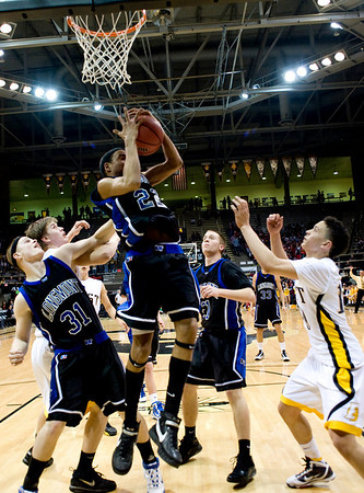 Longmont's Marcus Donaldson rebounds the ball during the semifinals of the boys 4A State Championships at the Coors Event Center on the University of Colorado campus in Boulder, Thursday, March 11, 2010. <br /> <br /> KASIA BROUSSALIAN