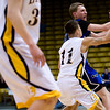 Longmont's Cade Kloster (behind) passes through the defense of Pueblo East's Josh Sandoval during the semifinals of the boys 4A State Championships at the Coors Event Center on the University of Colorado campus in Boulder, Thursday, March 11, 2010. <br /> <br /> KASIA BROUSSALIAN