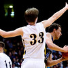 Longmont's Tevan McIntire (right) looks for an opening to pass while Pueblo East's Mitch Secora defends during the semifinals of the boys 4A State Championships at the Coors Event Center on the University of Colorado campus in Boulder, Thursday, March 11, 2010. <br /> <br /> KASIA BROUSSALIAN