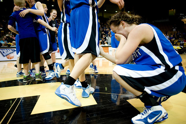 Longmont's Jamie Katuna cries after winning the semifinals against Mullen High School during the 4A State Basketball Playoffs at the Coors Event Center on the University of Colorado campus in Boulder, Wednesday, March 10, 2010. <br /> <br /> KASIA BROUSSALIAN