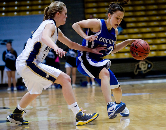Longmont's Erica Meier (right) pushes past Mullen's Tori Curneen during the 4A State Basketball Playoffs at the Coors Event Center on the University of Colorado campus in Boulder, Wednesday, March 10, 2010. <br /> <br /> KASIA BROUSSALIAN