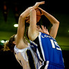Longmont's Tambre Haddock (front) is fouled by Mullen's Hayley Thompson during the 4A State Basketball Playoffs at the Coors Event Center on the University of Colorado campus in Boulder, Wednesday, March 10, 2010. <br /> <br /> KASIA BROUSSALIAN