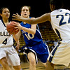 Longmont's Erica Meier (center) passes the ball while Mullen's Autumn Burt (left) and Bailey Holland during the 4A State Basketball Playoffs at the Coors Event Center on the University of Colorado campus in Boulder, Wednesday, March 10, 2010. <br /> <br /> KASIA BROUSSALIAN