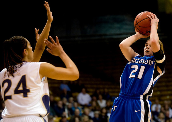 Longmont's Amber Thornholt (right) shoots over Mullen's Jordan Schott-Benson during the 4A State Basketball Playoffs at the Coors Event Center on the University of Colorado campus in Boulder, Wednesday, March 10, 2010. <br /> <br /> KASIA BROUSSALIAN