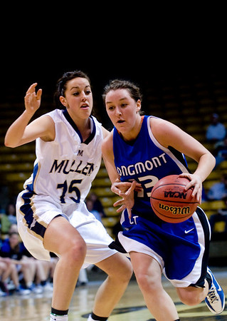 Longmont's Jamie Katuna (right) dribbles while Mullen's Kourtney Camy defends during the 4A State Basketball Playoffs at the Coors Event Center on the University of Colorado campus in Boulder, Wednesday, March 10, 2010. <br /> <br /> KASIA BROUSSALIAN