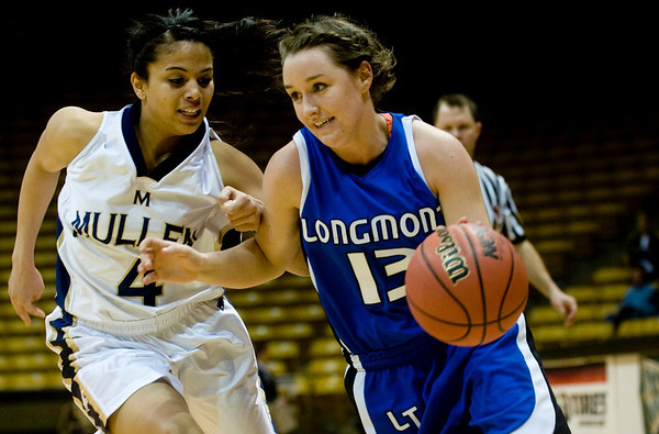 Longmont's Jamie Katuna (right) dribbles towards the basket as Mullen's Autumn Burt defends during the 4A State Basketball Playoffs at the Coors Event Center on the University of Colorado campus in Boulder, Wednesday, March 10, 2010. <br /> <br /> KASIA BROUSSALIAN