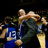 Longmont's Tambre Haddock hugs head coach Jay Darien after winning the semifinals against Mullen during the 4A State Basketball Playoffs at the Coors Event Center on the University of Colorado campus in Boulder, Wednesday, March 10, 2010. <br /> <br /> KASIA BROUSSALIAN