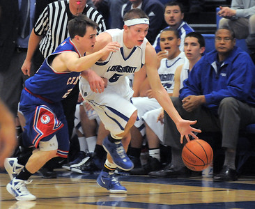 Longmont's Josh Cogdill, after stealing the ball, drives the ball downcourt past Centaurus' Trevor Schrader during Friday's game at Longmont.  For more photos please see www.dailycamera.com January 26, 2012 staff photo/ David R. Jennings