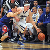 "Longmont's Josh Cogdill, after stealing the ball, drives the ball downcourt past Centaurus' Trevor Schrader during Friday's game at Longmont. <br /> For more photos please see  <a href=""http://www.dailycamera.com"">http://www.dailycamera.com</a><br /> January 26, 2012<br /> staff photo/ David R. Jennings"