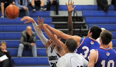 Longmont's Reilly Mau and Centaurus' Austin Tunquist reach for the ball during Friday's game at Longmont.  For more photos please see www.dailycamera.com January 26, 2012 staff photo/ David R. Jennings