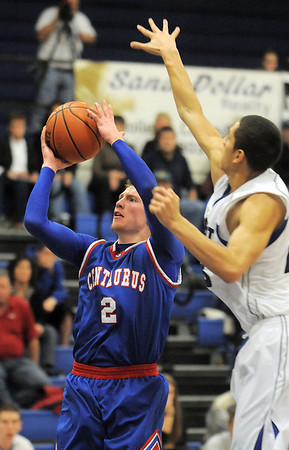 """Centaurus' Nate McGinley shoots the ball past Longmont's Brian Donaire during Friday's game at Longmont. <br /> For more photos please see  <a href=""""http://www.dailycamera.com"""">http://www.dailycamera.com</a><br /> January 26, 2012<br /> staff photo/ David R. Jennings"""