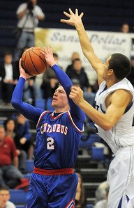 Centaurus' Nate McGinley shoots the ball past Longmont's Brian Donaire during Friday's game at Longmont.  For more photos please see www.dailycamera.com January 26, 2012 staff photo/ David R. Jennings